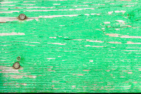 grey nails: Background of old board with peeling green paint and rusty nails Stock Photo