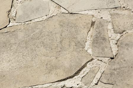 Einbuchtung: Gepflasterte Oberfl�che des grauen Schiefer hautnah