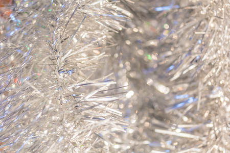 silver backgrounds: Blurred Christmas background of silver tinsel, close-up