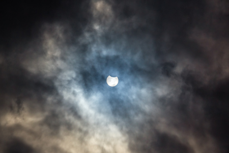 solar eclipse: Picturesque cloudy sky with partial solar eclipse Stock Photo
