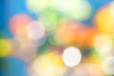 octahedron: Abstract blue background with blurry yellow, red, white, green spots
