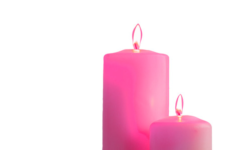 colourful lightings: Two pink burning candles, isolated on white background