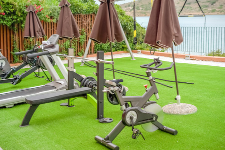 Gym on the terrace with an artificial turf by the sea in the open air, Greece, Crete