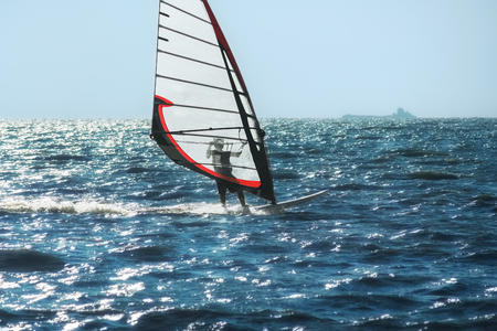 Windsurfing on the background of blue sea and sky, close up