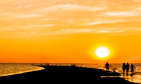 dimple: Picturesque orange sunset over the sea on the summer evening
