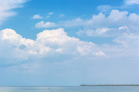 Picturesque seascape with white clouds in the blue sky on a summer day Reklamní fotografie