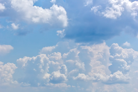 Picturesque cumulus clouds in the blue sky on a summer day