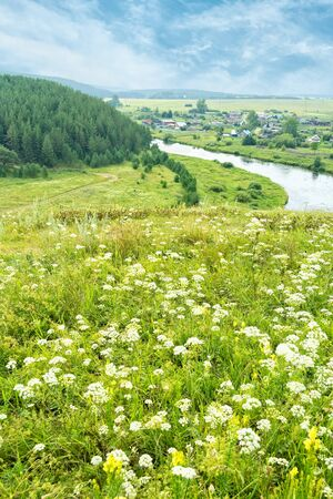 View of the river Rezh and the village of Aramashevo on a summer day, Russia, Ural