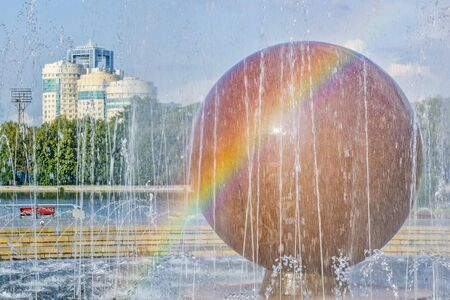 Cityscape with fountain on the square in the center of Yekaterinburg, Russia.  Embankment of the Iset river