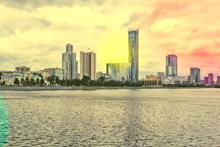 Embankment of the city pond of Yekaterinburg in the summer evening, Russia. Photo tinted
