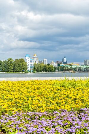Picturesque cityscape with flowerbed on the embankment of the city pond of Yekaterinburg, Russia 写真素材