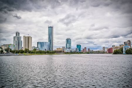 View from the embankment of the city pond of Yekaterinburg on the business center, Russia