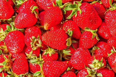 Strawberry. Crop of red ripe fresh berries, macro. Fruit background and texture