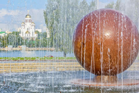 Picturesque cityscape with fountain on the square in the center of Yekaterinburg, Russia.  Embankment of the Iset river