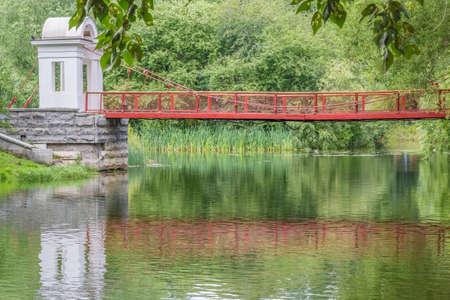 Picturesque landscape with suspension bridge in the park, close-up. Park of the Rastorguev-Kharitonov estate, Russia, Yekaterinburg Reklamní fotografie