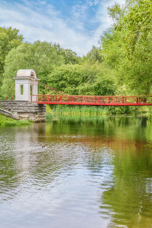 Picturesque landscape with suspension bridge in the park. Park of the Rastorguev-Kharitonov estate, Russia, Yekaterinburg