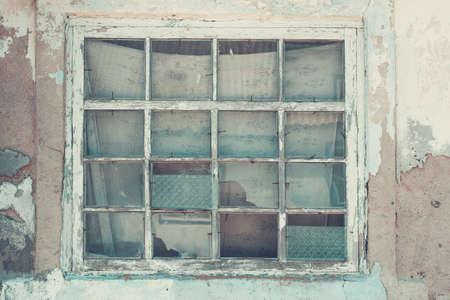 Old wooden window in a ruined house, close-up. Retro style