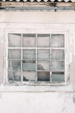 Old wooden window in a ruined house. Retro style Reklamní fotografie