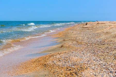 Sand spit on the sea on a summer day on a background of blue sky  Reklamní fotografie