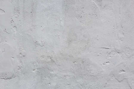 Background and texture of uneven plastered wall, close-up
