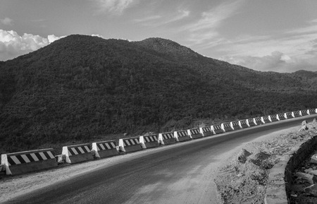 curving: Curving mountain road. BW