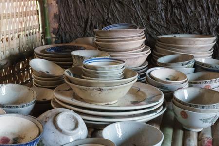 jumbled: Jumbled stack of porcelain plates, cups, saucers