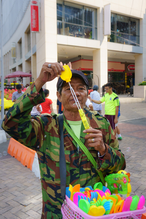 austere: Old man with bubble wand