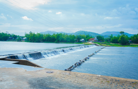 spillway: Water over TamGiang Dam Stock Photo
