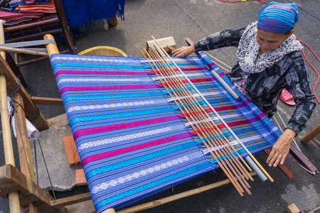 handloom: The woman weaves traditional fabric