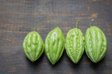 gourds: Bitter gourds isolated on wood background