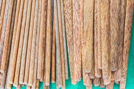 Bamboo chopsticks isolated on green Stock Photo