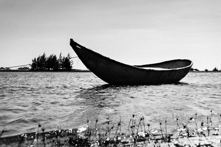 ange: Boat in river. Black and white