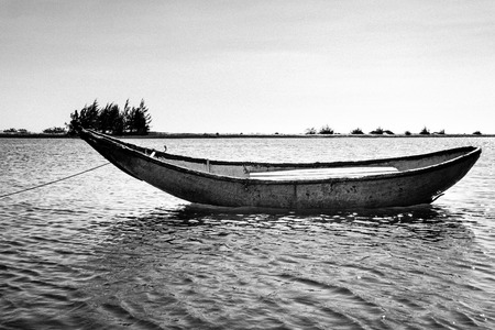ange: Boat in the river. Black and white