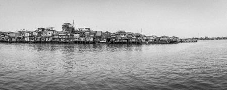 midday: Panorama houses on river. Black and white Stock Photo