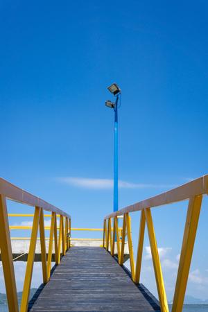 vanishing point: Yellow pier Stock Photo