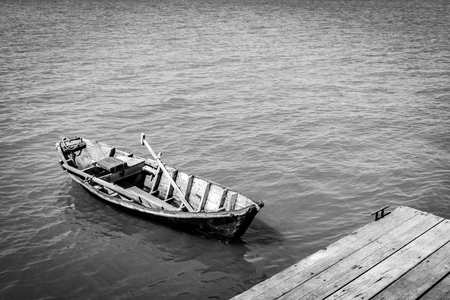 ange: Boat anchor on pier. Black and white