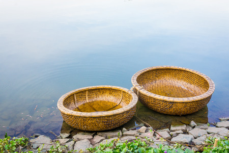 Two Coracles in river