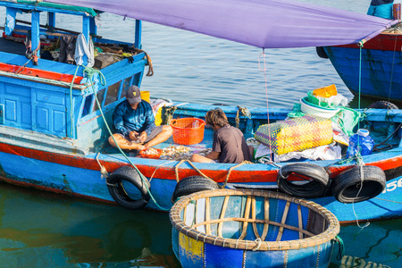 Two men working in fish boats