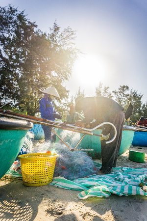 The people catching fishing on fishnet in Ke Ga beach Editorial