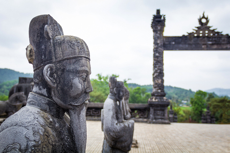 Stone soldiers statues protecting Khai Dinh tomb in Hue Vietnam Imagens