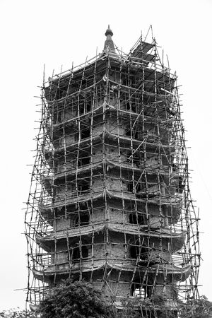 Tower of pagoda buiding unfinished. Black and white