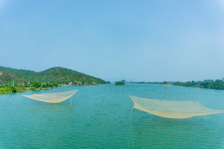 backwater: Landscape of river with fishing net Stock Photo