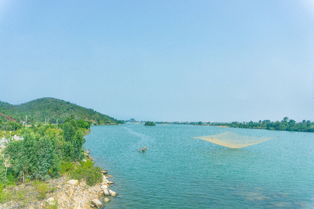 Beautiful landscape with river and fish net