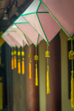 The yellow lanterns hanging in pagoda at Hue Vietnam