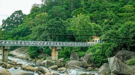 Landscape of the steel bridge on the stream