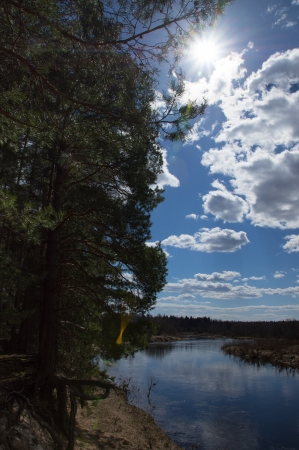 small blue river by a sunny day photo