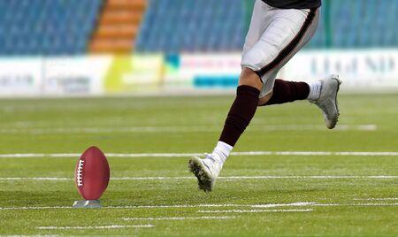 American football player kickoff on field 写真素材