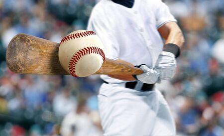 Baseball player hitting ball with bat in close up 版權商用圖片