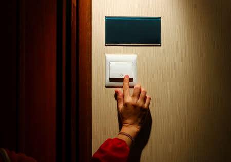 Hand pressing door bell