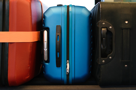 Travel concept, colorful plastic and fabric suitcases